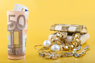 Concept or Metaphor for selling old gold jewelry for cash
