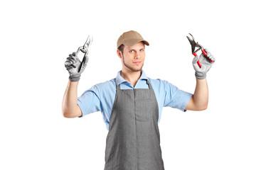 Male gardener holding pliers
