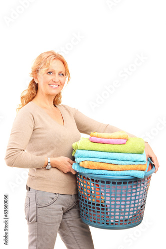 Mature lady holding a laundry basket