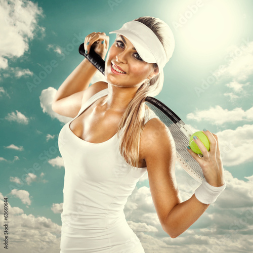 Successful woman with racket at the tennis court
