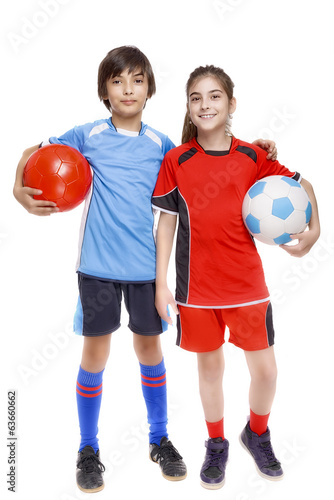 Couple of girl and boy dressed in soccer equipment