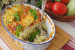 casserole of pasta with zucchini and tomato , cheese