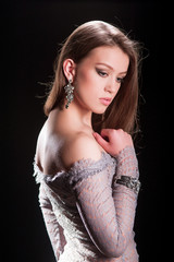 beautiful young woman in fashionable dress