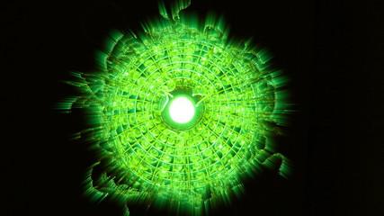 Swinging in the dark glowing green light spherical illuminator