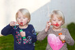 canvas print picture - Two beautiful blond twins blowing bubbles