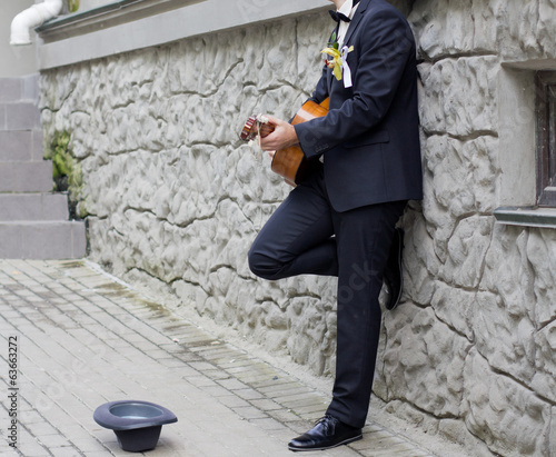 Groom playing the guitar