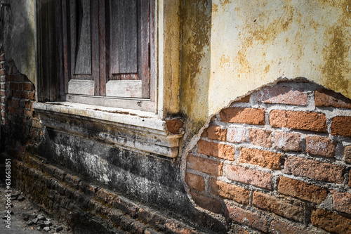wooden windows on grunge old wall