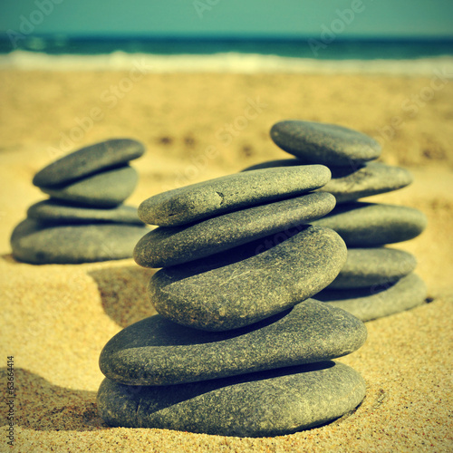 stones on the beach, with a retro effect