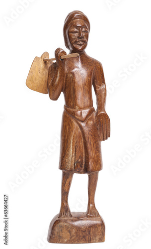 Statuette of standing man with bag hanging on stick, Sri Lanka