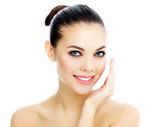 Fototapety Cheerful female with fresh clear skin, white background