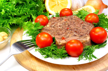 jellied meat with fresh herbs and cherry tomatoes