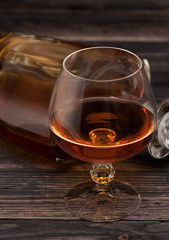 Glass of brandy on dark background