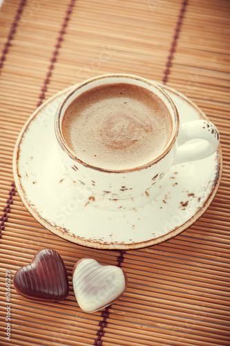 Cup of coffee and chocolate candy in vintage style