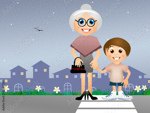 boy with old lady in the crosswalk