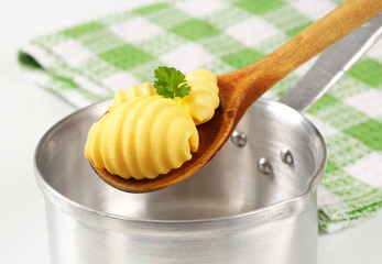 Butter curls on wooden spoon