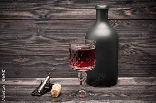 Red wine and vintage corkscrew