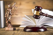 Lady of justice, wooden & gold gavel and books on wooden table - 63665679