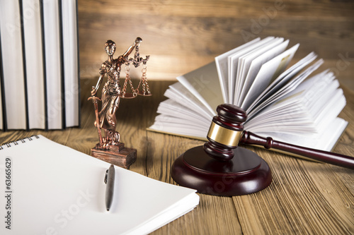 Leinwanddruck Bild Lady of justice, wooden & gold gavel and books on wooden table