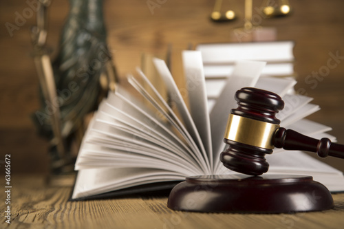 Lady of justice, wooden & gold gavel and books on wooden table - 63665672