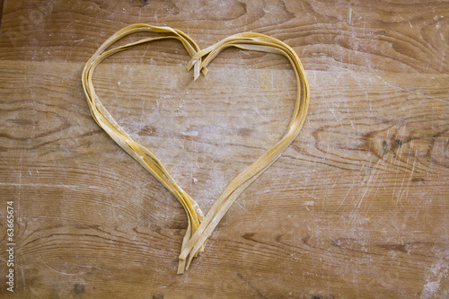 Homemade fettuccine with heart shape