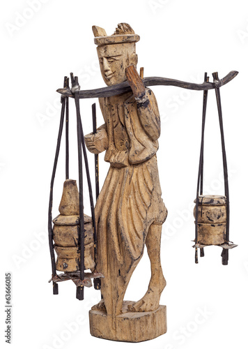 statuette of man carrying baskets on stick