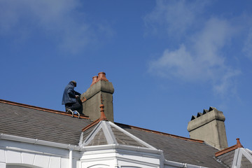 Workman repairing a chimney stack