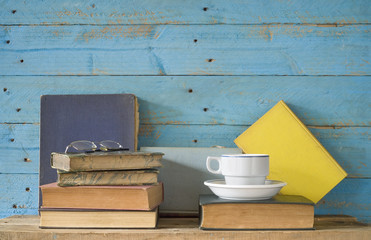 old books with a cup of coffee and eyeglasses, free copy space