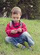 Child sitting in grass