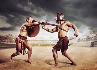 Gladiators fighting on the arena of the Colosseum