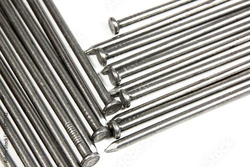 Extreme Closeup of Large Wire Nails on White