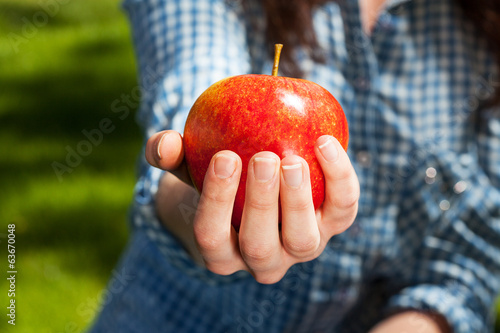 Squeezing an apple