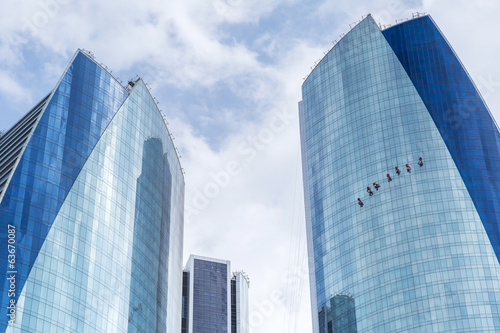 Window cleaners working on the glass building