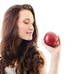 Attractive teen girl with an apple against white background