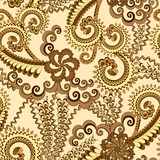 ornate pattern in brown and yellow tones