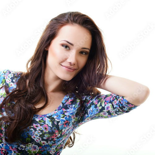 Beautiful young woman with beauty long brown hair posing at stud