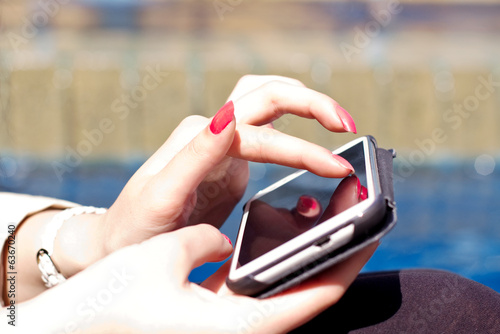 female fingers tpuching smartphone screen