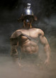 Gladiator standing in a smoke in helmet and with sword