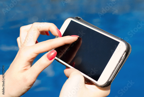female finger touching smartphone screen