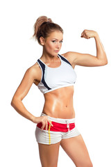 Young beauty fitness sexy woman showing her muscles