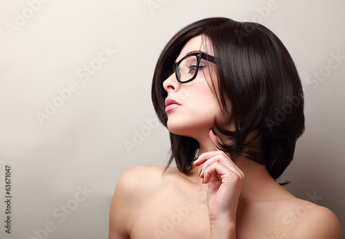 Beautiful woman thinking in glasses. Closeup portrait