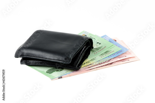 Black leather wallet and bank note