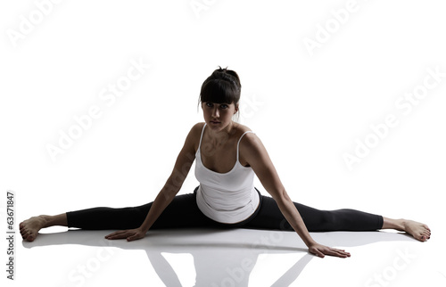 splits, portrait of sport girl doing yoga stretching exercise, s