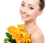 Beauty face of young beautiful woman with flower. Girl with oran