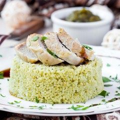 Couscous with pesto sauce, fried sliced pork, tasty dish