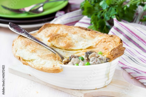 Meat pie with stew of chicken, mushrooms, peas, puff pastry