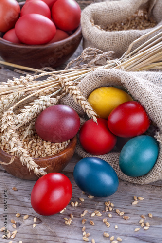 Painted eggs in a linen sack for the celebration of Easter