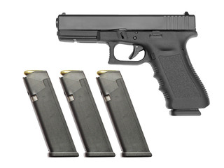 Handgun with three full magazines isolated on white background.