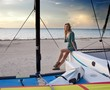 canvas print picture - young woman at sports boats