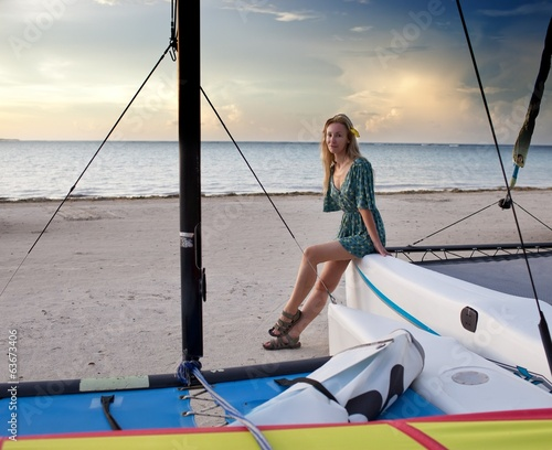 canvas print picture young woman at sports boats