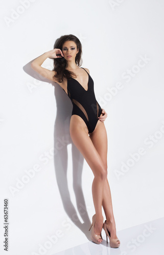 Fashion photo of a beautiful and young lady in a swimsuit